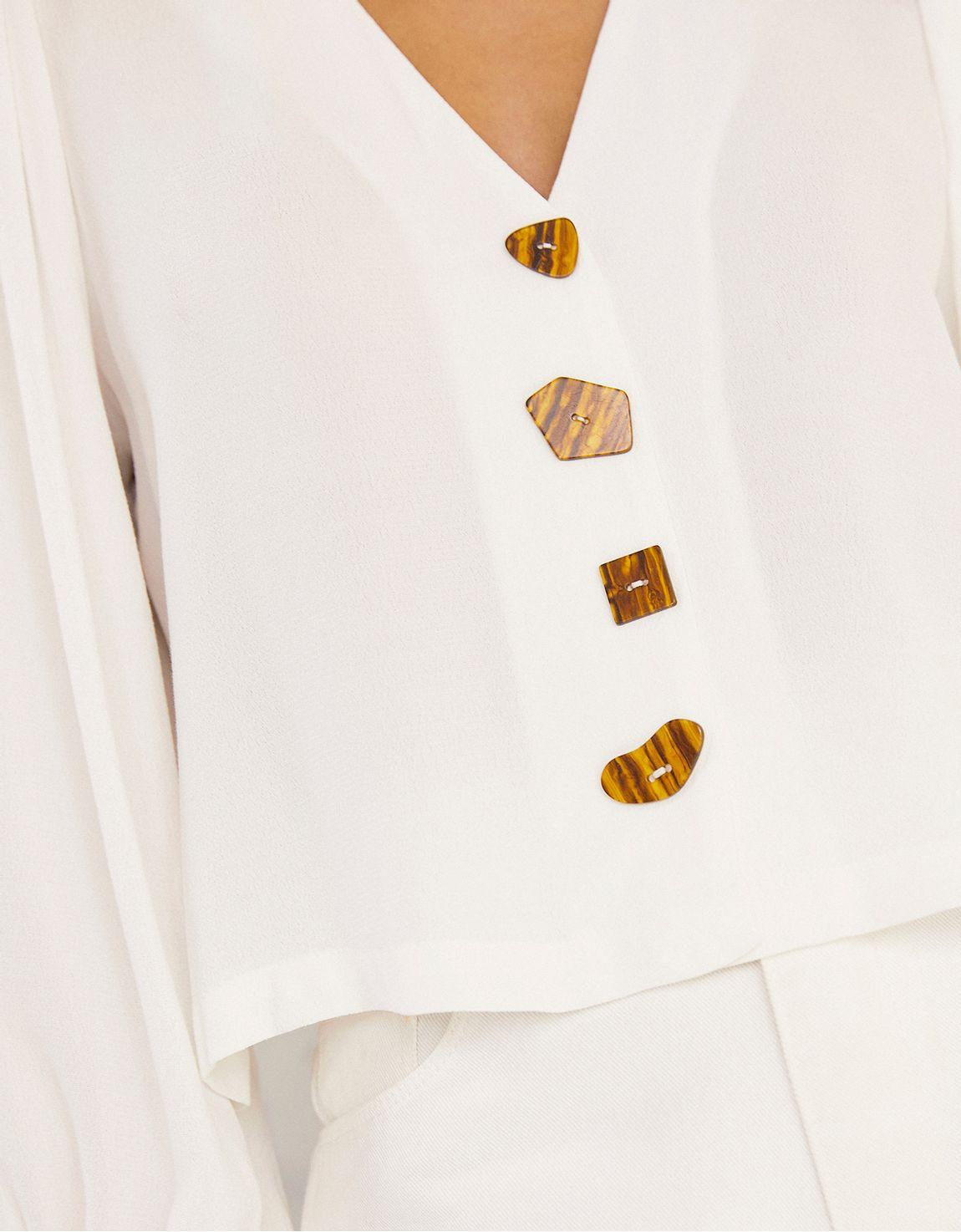 Blusa reta botões diferentes