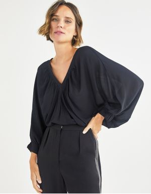 Blusa ampla decote v
