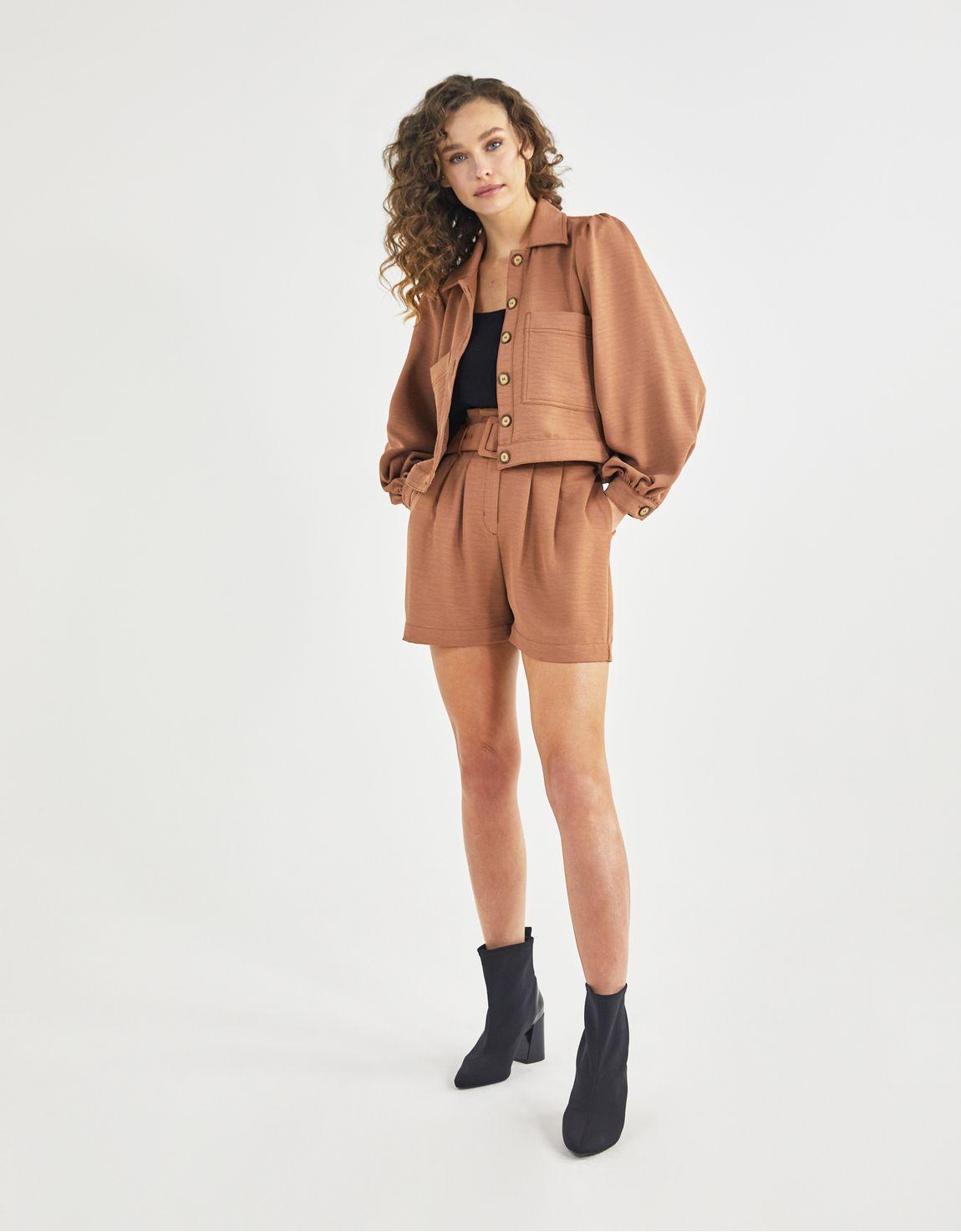 Jaqueta bolsos manga bufante